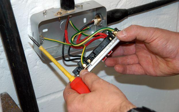 Electrician rewires socket