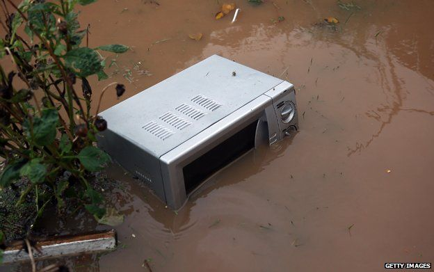 Microwave stands in floodwater