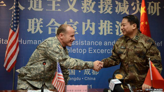Major General Stephen R Lyons of the US Army, Pacific shakes hands with Major Tang Fen of the PLA
