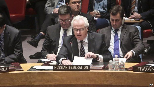 Russia's ambassador to the United Nations Vitaly Churkin speaks after a UN Security Council vote on the Syria humanitarian crisis on 22 February 2014