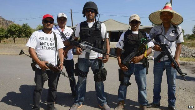 """Members of a """"self-defence group"""" pose for a picture in Antunez, Michoacan state, on 15 February, 2014"""