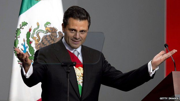 Newly-sworn in Mexican President Enrique Pena Nieto delivers his first speech as head of state at the National Palace in Mexico City on 1 December, 2012