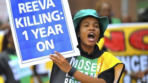 Members of the ruling African National Congress Women's League march in Pretoria on the anniversary of the killing of Reeva Steenkamp, 14 February 2014