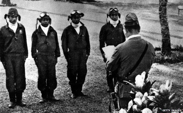 Four kamikaze pilots receiving orders