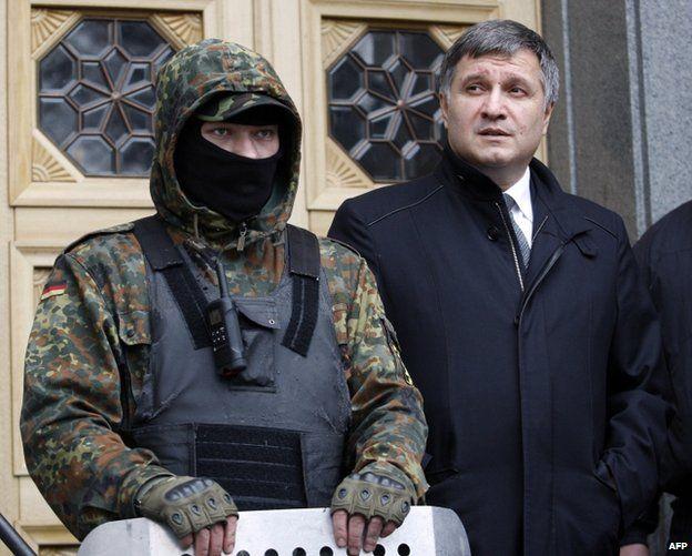 Arsen Avakov beside a paramilitary guard outside parliament in Kiev, 22 February