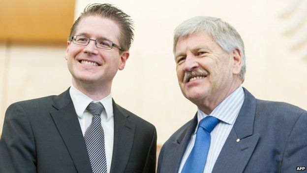 Udo Voigt, member of the German far-right party NPD (R) and Peter Richter, the party's lawyer
