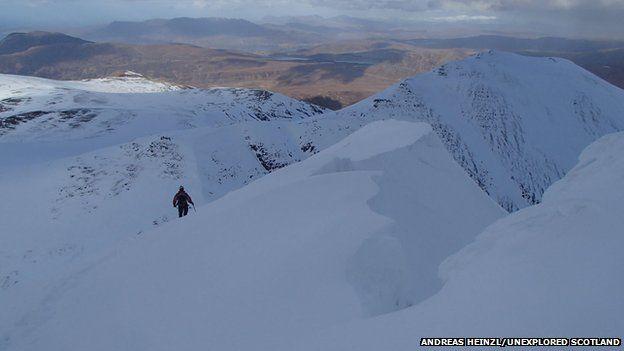 Walker descending descending off Bidein a' Ghlas Thuill