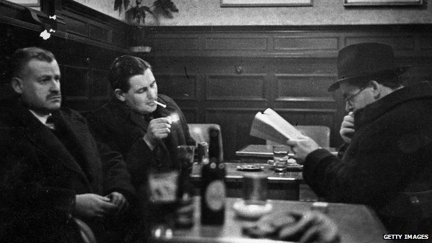 Irish novelist Flann O'Brien (right) with friends in the Palace Bar in Dublin