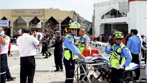 Emergency services workers outside the destroyed restaurant