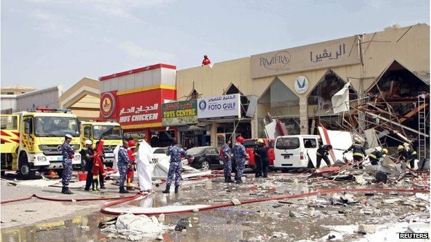 The destroyed restaurant with debris scattered around it, after the explosion