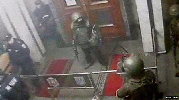 Security camera captures armed men inside regional parliament in Simferopol
