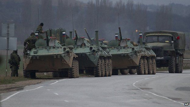 Russian armoured personnel carriers and a truck are near the town of Bakhchisarai, Crimea. 28 Feb 2014