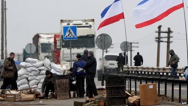 """Men calling themselves """"local militia"""" at a checkpoint the city of Armyansk"""
