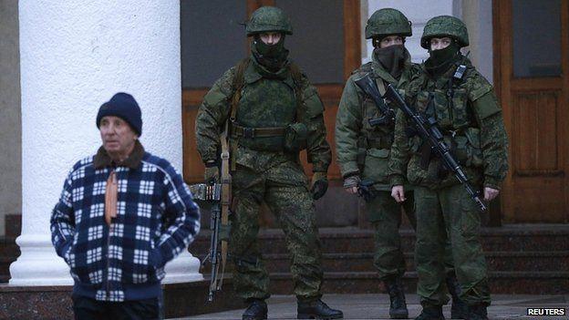 Armed men patrol at the airport in Simferopol. 28 Feb 2014
