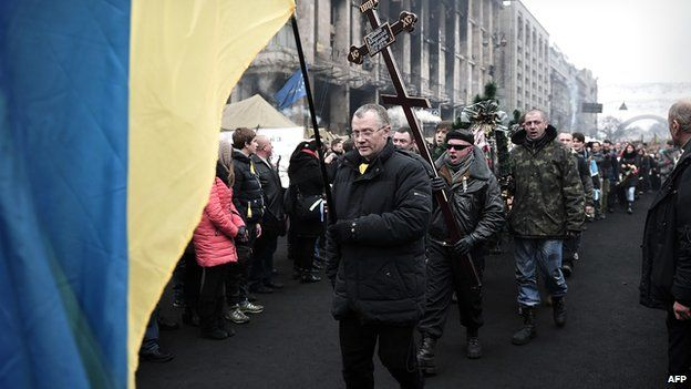 Funeral procession for victim of recent clashes with police, in Kiev on 1 March 2014