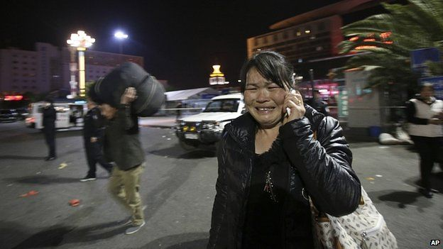 Woman cries at scene of stabbing. 1 March 2014