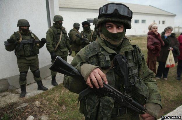 Russian soldiers outside a Ukrainian base in Perevalnoye, Crimea, 2 March