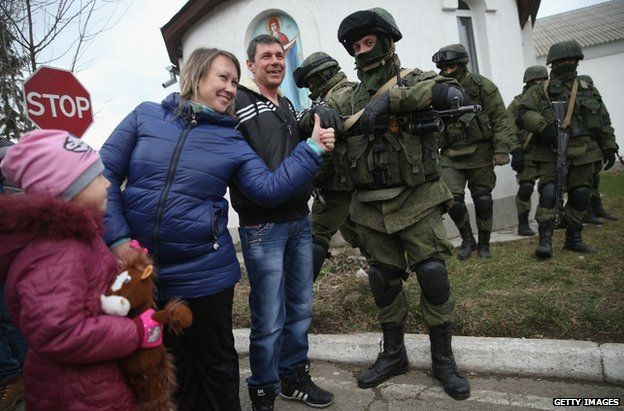 Russian soldiers with civilians outside a Ukrainian base in Perevalnoye, Crimea, 2 March