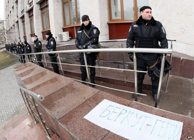 Apparent Berkut riot police guard a rally in Donetsk, eastern Ukraine, 2 March