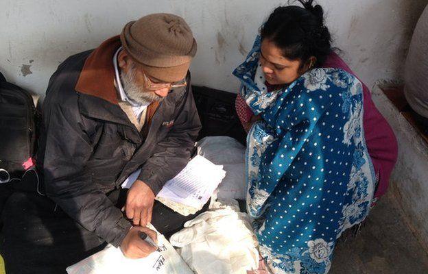 Jagdish Chandra Sharma writes address on a parcel