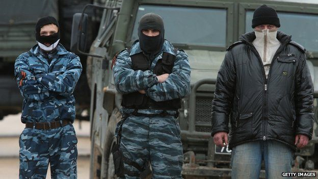 A line of pro-Russian militants have been guarding the Russian-occupied Belbek airbase