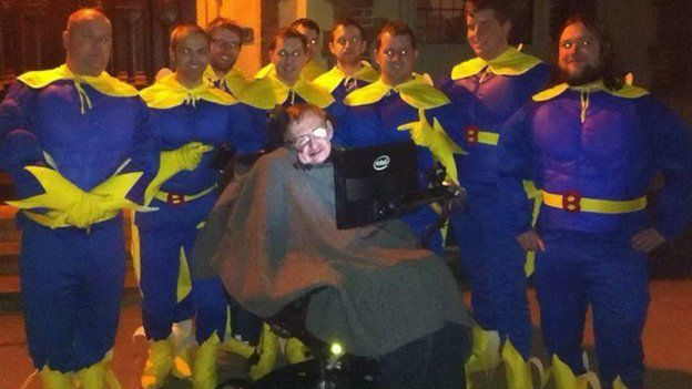 Chris Hallam and friends dressed as Bananaman with Prof Stephen Hawking