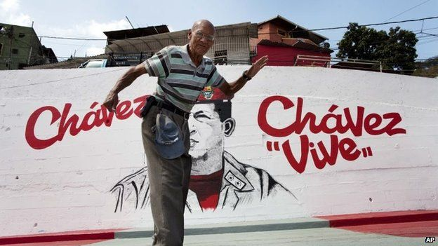 A man walks past a mural of Venezuela's late President Hugo Chavez in Caracas on 4 March, 2014