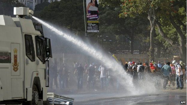 A water cannon is fired at protesters in Caracas on 4 March, 2014