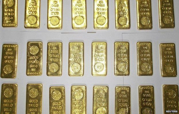 Seized gold bars are kept on display by customs officers at the international airport in Calcutta on November 19, 2013