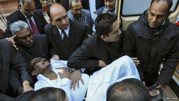 An MP is rushed to hospital in Delhi on February 13, 2014 after an MP fires pepper spray in the lower house