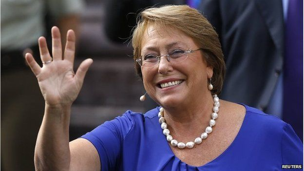 Chiles President-elect Michelle Bachelet waves to the media as she leaves after several meetings with authorities in Santiago on 10 March, 2014