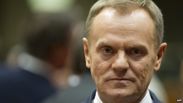 Polish Prime Minister Donald Tusk arrives on March 6, 2014, at the EU headquarters in Brussels, ahead of an emergency summit on the crisis in Ukraine