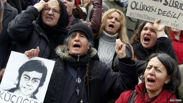Anti-government protesters shout slogans during a demonstration marking the funeral of Berkin Elvan