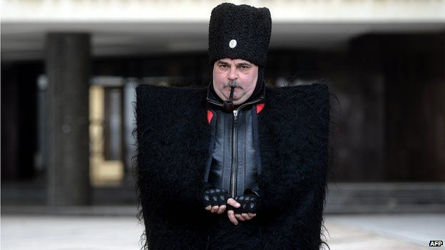 Cossack guard in front of Crimea's regional government in Simferopol on 12 March 2014