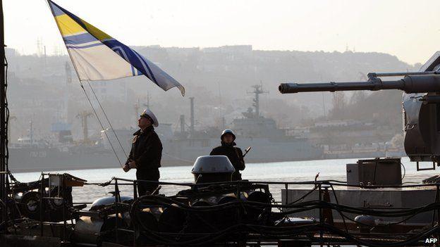 Sailor hoists Ukrainian flag on a naval ship in Sevastopol, Crimea, on 12 March 2014