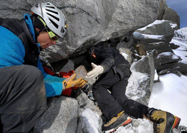 Stephane Dan and Alexandre Pittin find a piece of quartz in a cavity in La Dent du Geant, Mont Blanc