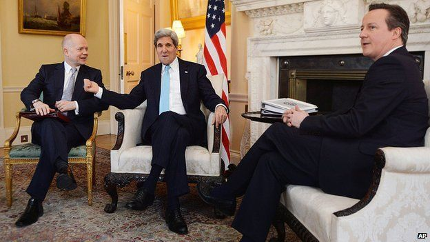 UK Prime Minister David Cameron, right and Foreign Secretary William Hague meet with US Secretary of State John Kerry in Downing Street, central London on 14 March 2014.