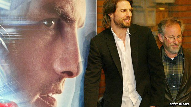 Tom Cruise and Steven Spielberg in front of Minority Report poster
