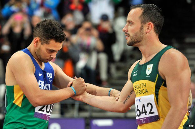 Brazilian Paralympian Oliveira is congratulated by Pistorius after the 200m race