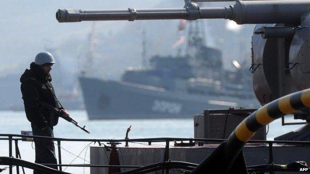 A sailor stands guard on Ukraine's Slavutych military ship in Sevastopol, 18 March