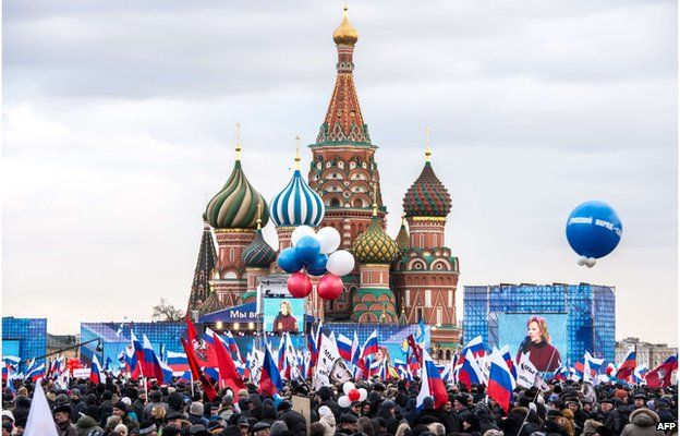 Pro-Kremlin activists rally in Moscow's Red Square on 18 March, to celebrate the incorporation of Crimea into the Russian Federation