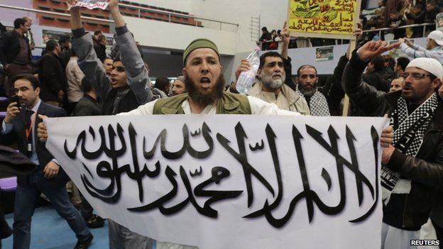 A protester holds up a sign at the rally on 21 March calling for the boycott of the Algerian presidential election