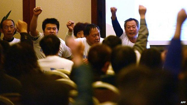 Relatives in Beijing continue to show their frustration, during a briefing on Saturday, 22 March