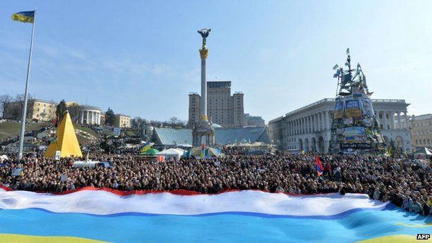 People wave a giant flag - a combination of a Ukrainian and a Crimean flags - during a unity rally in Kiev. Photo: 23 March 2014