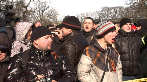 Russian-speaking protesters shout at WWII veterans marching in Riga, Latvia