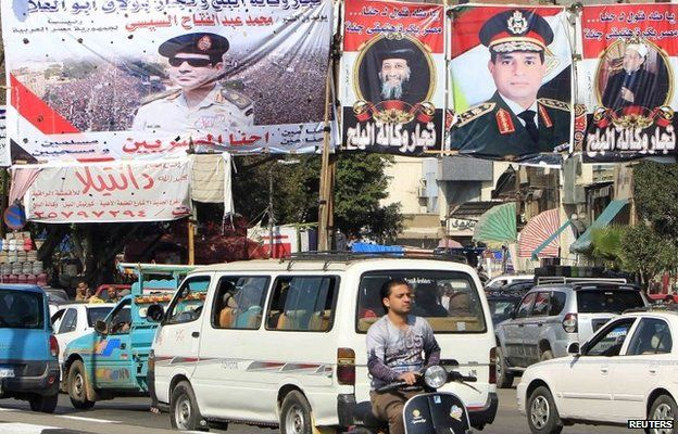 Vehicles pass banners in Cairo praising Field Marshal Abdul Fattah al-Sisi, as well as the Grand Sheikh of al-Azhar, Ahmed al-Tayyib, and Pope Tawadros II of the Coptic Orthodox Church