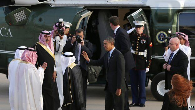 President Barack Obama waves to Governor of Riyadh Prince Khalid Bandar bin Abdul-Aziz Al-Saud and other Saudi officials next to his helicopter in Riyadh, Saudi Arabia, on Friday, March 28, 2014