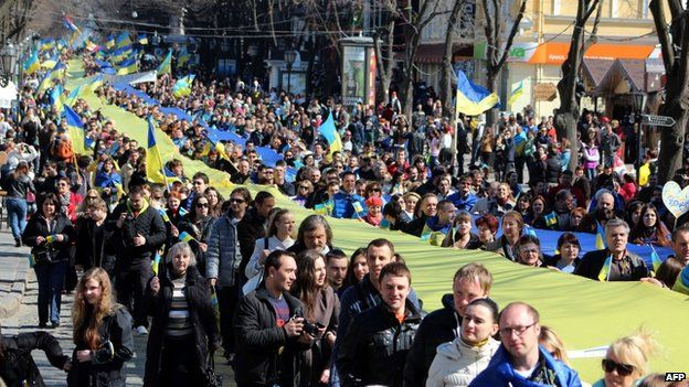 Pro-European supporters hold a large Ukrainian flag during a rally in Odessa, Ukraine, on 30 March 2014