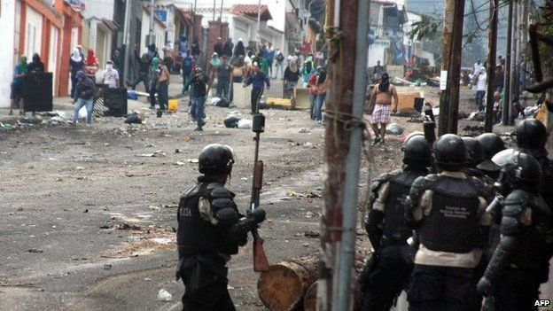 Riot police stand by during a protest against Venezuelan President Nicolas Maduro in San Cristobal on 28 March, 2014