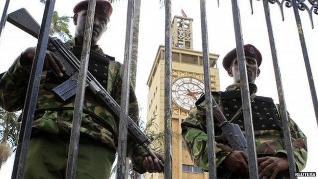 Two Kenyan guards patrol outside the parliament building in Nairobi - 27 March 2014